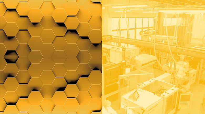 Żółty boks przedstawiający hale produkcyjną